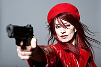 woman in red with gun